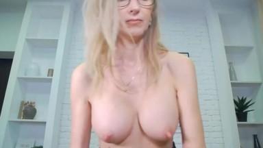 Mature boss is masturbating in her office