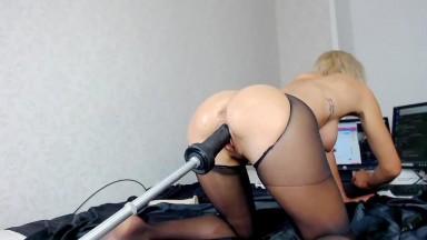 Blonde babe is taking a big fuck machine