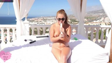 Naked tanning on the balcony